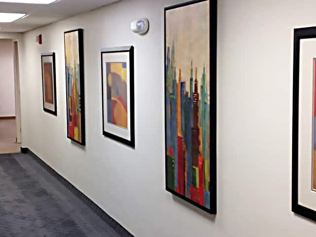 framed art in office hallway